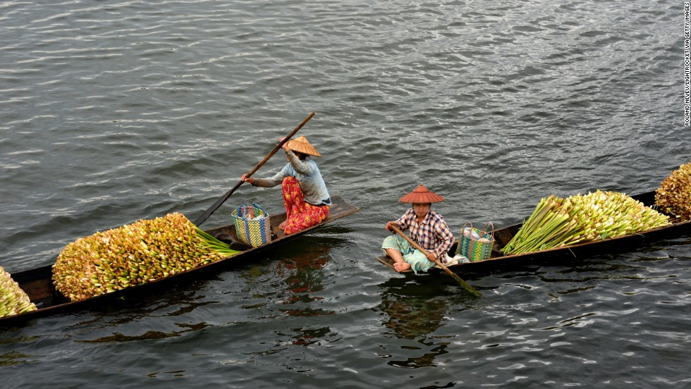 People transport flowers across Inle Lake, a large freshwater lake.
