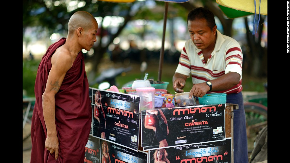 A Buddhist monk checks out a stand in Pyinmana.