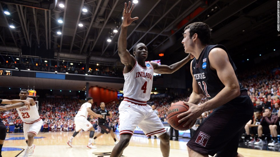 Victor Oladipo of the Indiana Hoosiers, center, defends the inbound pass of T.J. DiLeo of the Temple Owls on March 24 in Dayton, Ohio. Indiana won 58-52.