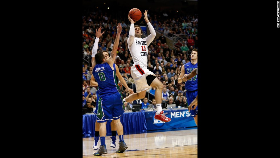 James Rahon of San Diego State shoots over Florida Gulf Coast players on March 24.