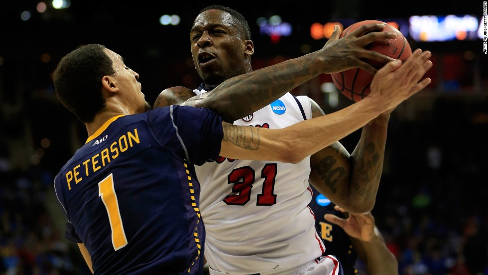 Murphy Holloway of the Ole Miss Rebels drives against D.J. Peterson of the La Salle Explorers on March 24 in Kansas City, Missouri. La Salle won 76-74.