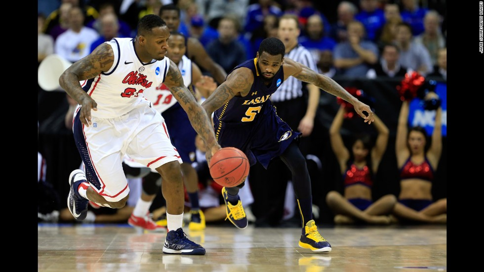 Murphy Holloway of Ole Miss and Ramon Galloway of La Salle chase down the ball on March 24.
