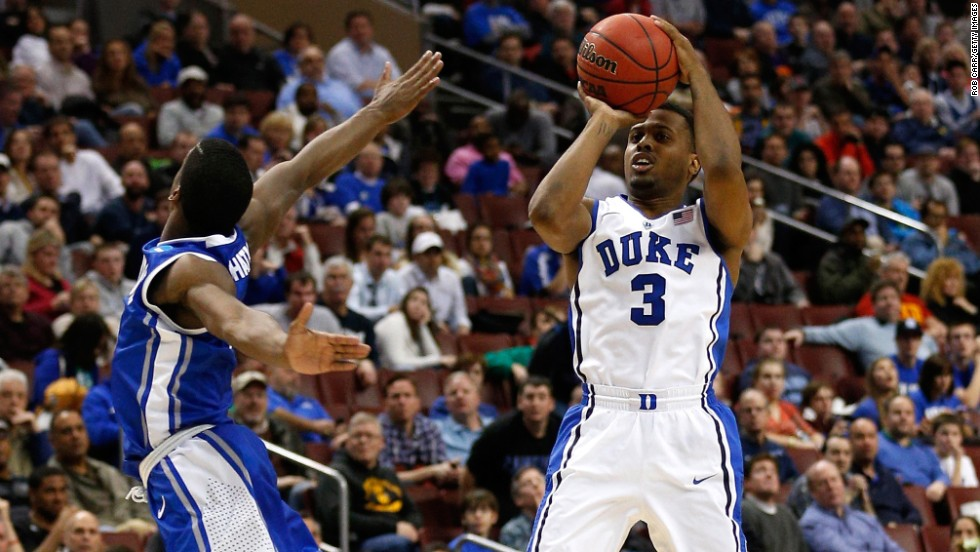 """Tyler Thornton of the Duke Blue Devils shoots a three-pointer at the halftime buzzer against the Creighton Bluejays on March 24 in Philadelphia. Duke won 66-50. Check out the action from the third round of the 2013 NCAA tournament and <a href=""""http://www.cnn.com/2013/03/21/worldsport/gallery/ncaa-round-of-64/index.html"""" target=""""_blank"""">look back at the NCAA tournament Round of 64</a>."""