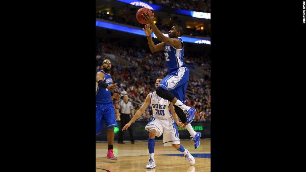 Jahenns Manigat of Creighton shoots over Seth Curry of Duke on March 24.