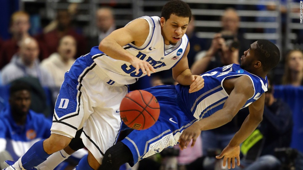 Seth Curry of Duke, left, is fouled by Jahenns Manigat of Creighton on March 24.