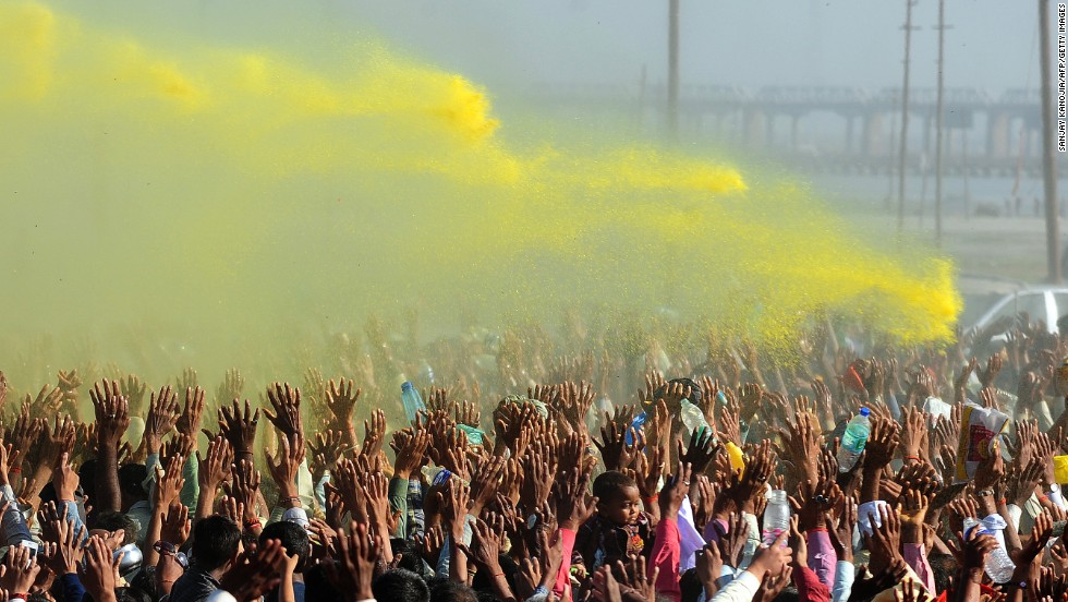 Colored powder billows over the crowd during the Kumbh Mela festival in Allahabad, India, on March 9, 2013, during which pilgrims symbolically wash off their sins in a two-month-long festival.