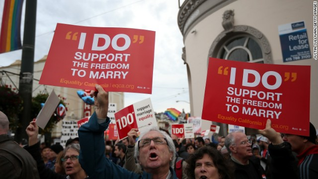 Supporters of same-sex marriage hold signs during a rally in support of marriage equality on March 25, 2013 in San Francisco, California. Supporters of same-sex marriage held a rally and are set to march through San Francisco a day before the U.S. Supreme Court will hear arguments on California's Proposition 8, the controversial ballot initiative that defines marriage as between a man and a woman.