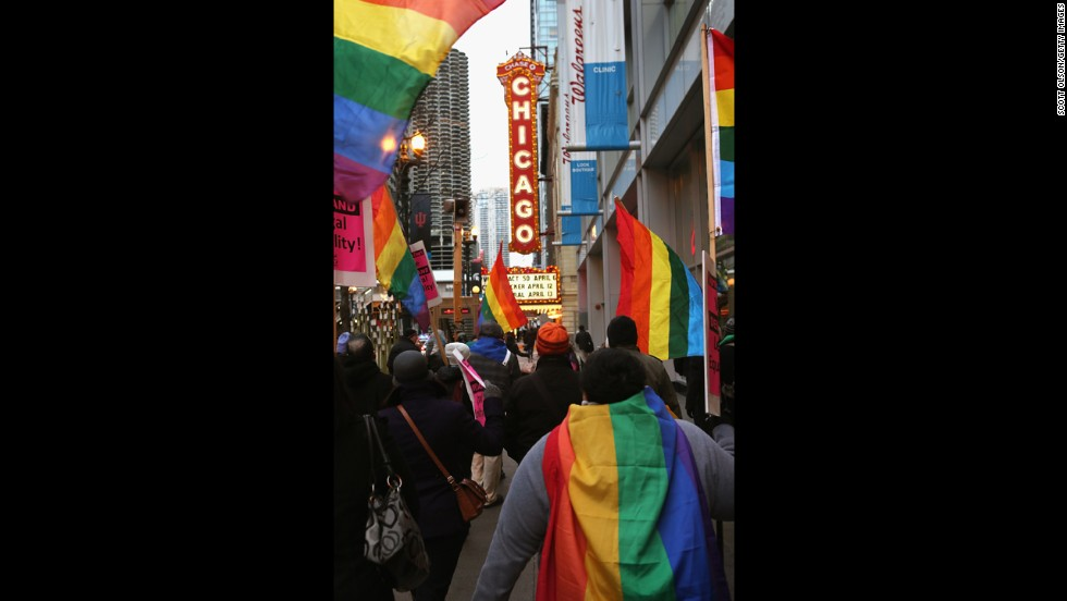 Demonstrators carry flags through the streets of Chicago on March 25.