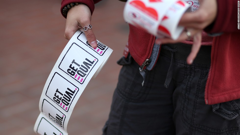A supporter of same-sex marriage passes out stickers in San Francisco.
