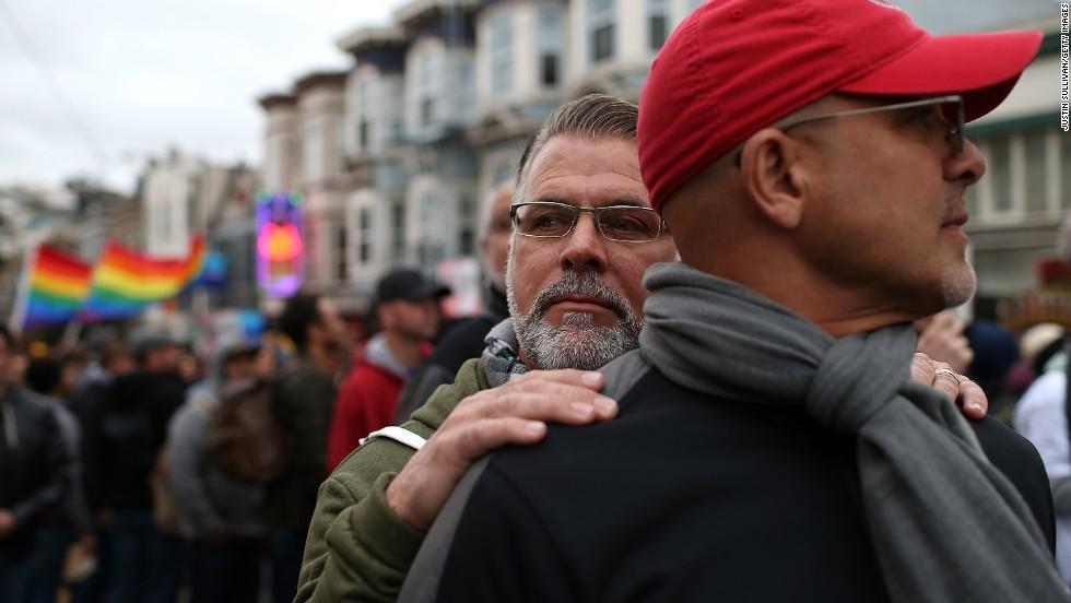 Ken Mauldin, left,  hugs Larry Davanzo during the demonstration in San Francisco.