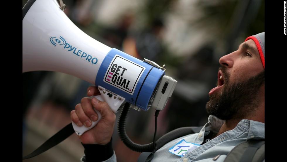 Trey Allen yells into a bullhorn during the rally in San Francisco.