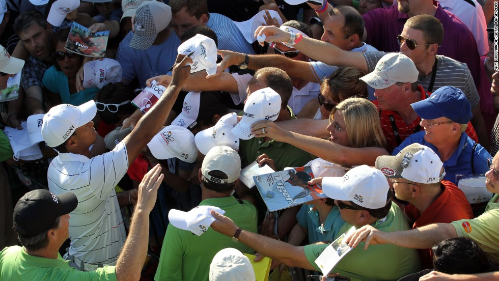 "Woods signs autographs at the<a href=""http://www.cnn.com/2012/03/25/sport/golf/golf-arnold-palmer-tiger/index.html""> Arnold Palmer Invitational</a> in March 2012. His win there marked his first PGA Tour victory since September 2009."