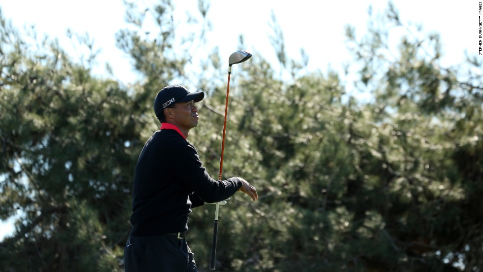 "Woods hits his tee shot on the 12th hole during the final round of the Farmers Insurance Open at Torrey Pines in January 2013. <a href=""http://money.cnn.com/2012/07/17/news/economy/tiger-woods-pay/index.htm"">He lost his title the previous year as the world's top-paid athlete</a>, dropping to third place on <a href=""http://sportsillustrated.cnn.com/specials/fortunate50-2012/index.html"">Sports Illustrated's ""Fortunate 50"" list</a>."