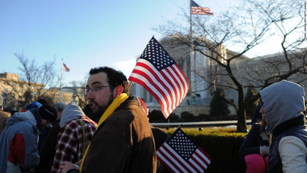 People line up in front of the Supreme Court on Tuesday.