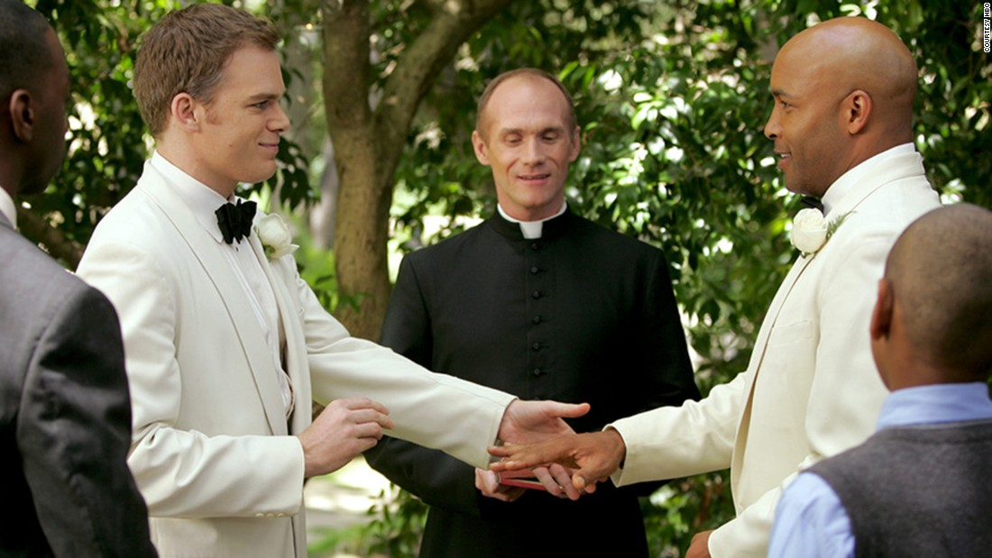 "Critics hailed the realistic portrayal of the relationship between David Fisher (Michael C. Hall, left) and Keith Charles (Mathew St. Patrick) on ""Six Feet Under."""