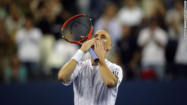 NEW YORK - AUGUST 28:  Andre Agassi blows kisses to the crowd after winning the match against Andrei Pavel of Romania during the first round of the US Open at the USTA Billie Jean King National Tennis Center in Flushing Meadows Corona Park on August 28, 2006 in the Flushing neighborhood of the Queens borough of New York. Agassi defeated Pavel 6-7 (4),7-6(8),7-6(6),6-2.  (Photo by Matthew Stockman/Getty Images)
