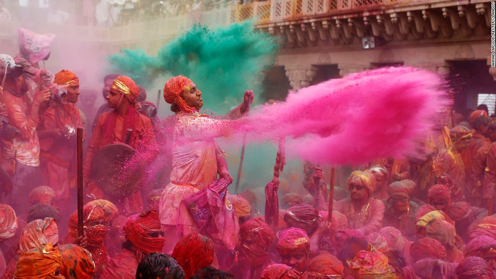A man flings pink powder over celebrants in Nandgaon on March 22.