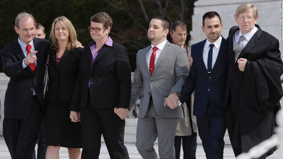 From left, attorney David Boies, plaintiffs Sandra Stier, Kris Perry, Jeff Zarrillo and Paul Katami, and attorney Theodore B. Olson exit together from the Supreme Court after their case against California's Proposition 8 was argued on Tuesday, March 26.