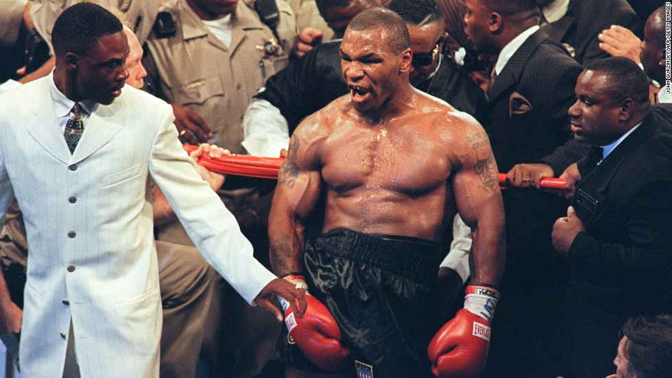 In 1992, Mike Tyson was charged and convicted for rape. After his release in 1995, Tyson resumed boxing and quickly regained two of his championship belts. Since then, Tyson has become a pop culture figure and in 2011 was inducted into the International Boxing Hall of Fame. Pictured here, Tyson reacts after being disqualified for biting Evander Holyfield's ear on June 28, 1997.