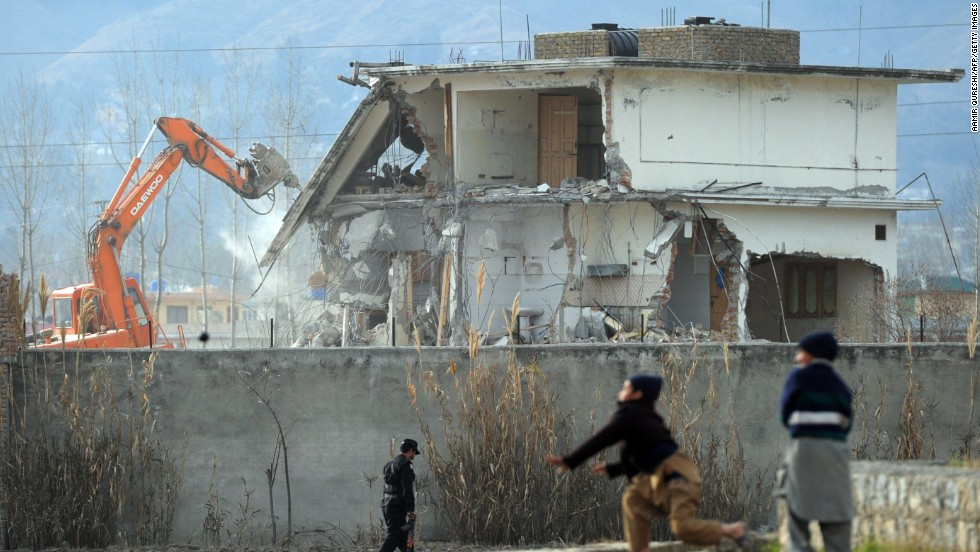 A demolition crew works to dismantle the compound on February 26, 2012.