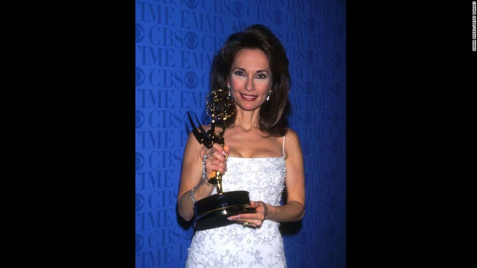 Susan Lucci holds her Daytime Emmy Award in 1999, which she won after losing in the same category 18 consecutive times.
