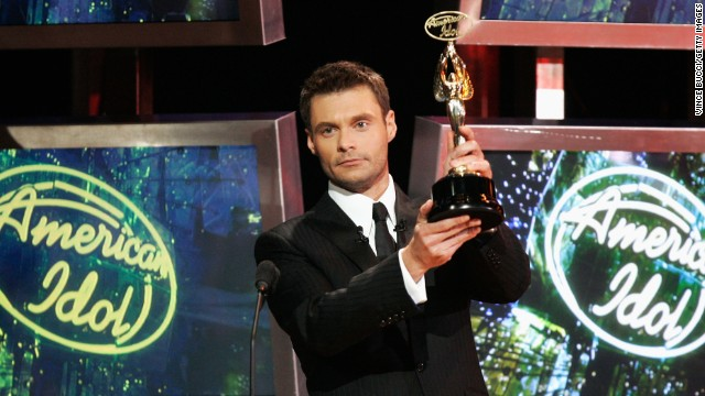 LOS ANGELES, CA - MAY 24:  American Idol host Ryan Seacrest presents an award onstage during the American Idol Season 5 Finale on May 24, 2006 at the Kodak Theatre in Hollywood, California.  (Photo by Vince Bucci/Getty Images)