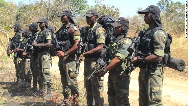 Cameroonian soldiers on patrol for poachers are pictured on December 15 during a press field trip at Bouba N'Djida National Park.