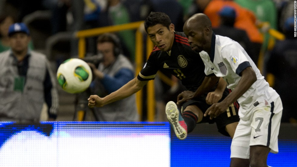 Mexico's Javier Aquino and U.S. defender DaMarcus Beasley  go to head to head for ball during their 2014 World Cup qualifying football match at Azteca Stadium in Mexico City on Tuesday, March 26. The regional rivals tied 0-0.