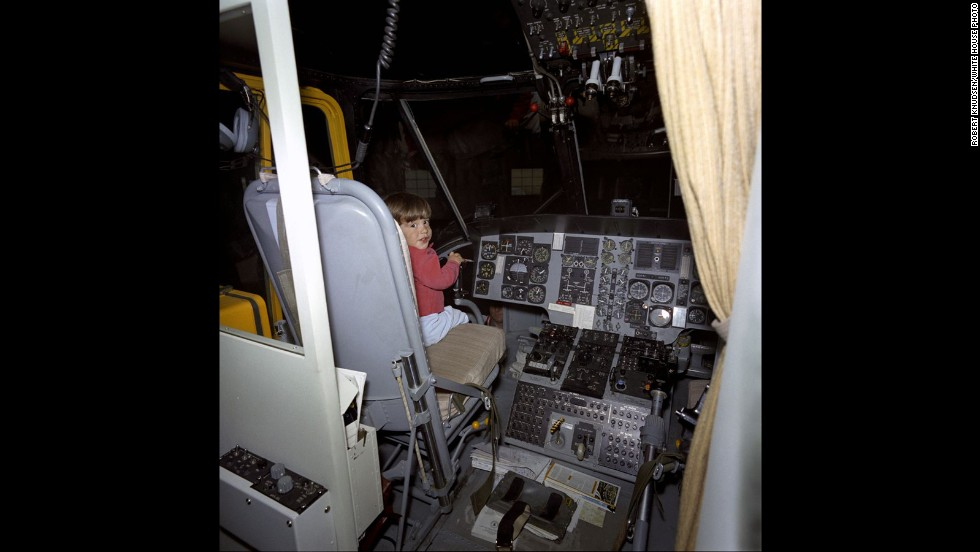 John Jr. in the pilot's seat of the presidential helicopter.