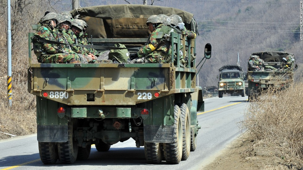 South Korean soldiers ride in a military truck in Paju on March 27.
