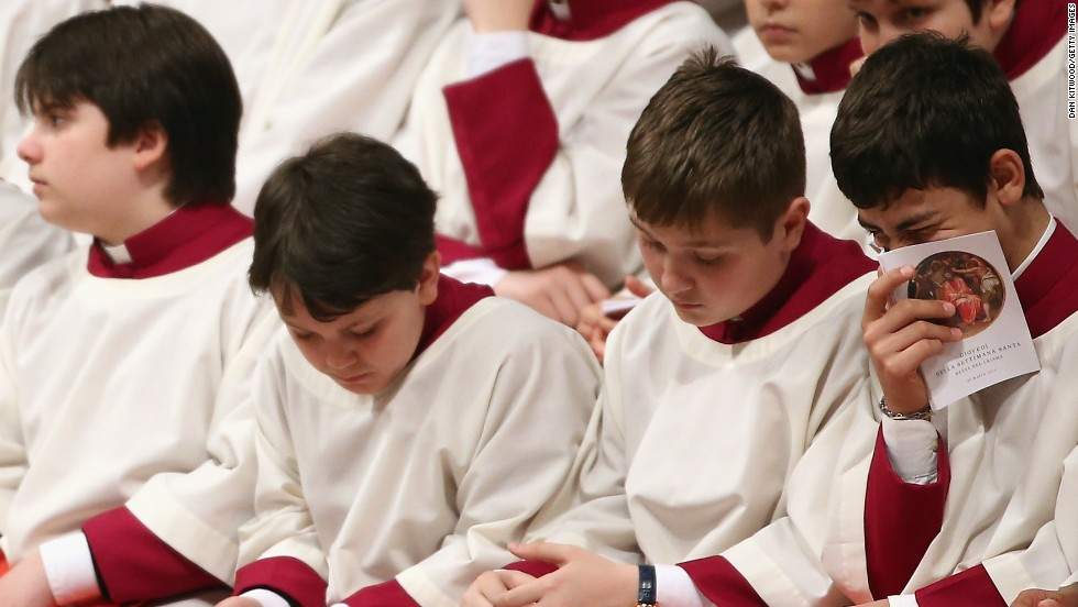 Choirboys fill a line of church benches on Thursday.