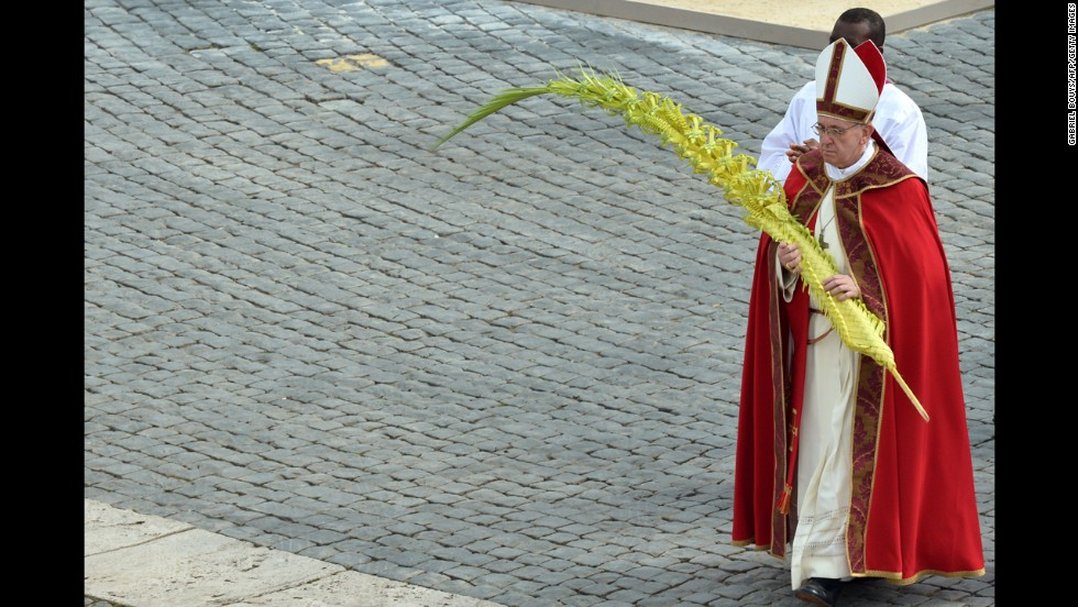 Pope Francis walks after blessing the palms on Palm Sunday.