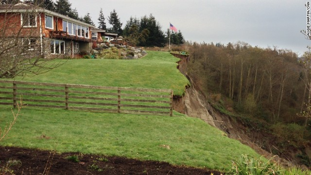 A massive landslide in Washington has destroyed one home and threatens more than a dozen others in Coupeville on Whidbey Island. No injuries were reported. The reason for the slide is unclear.