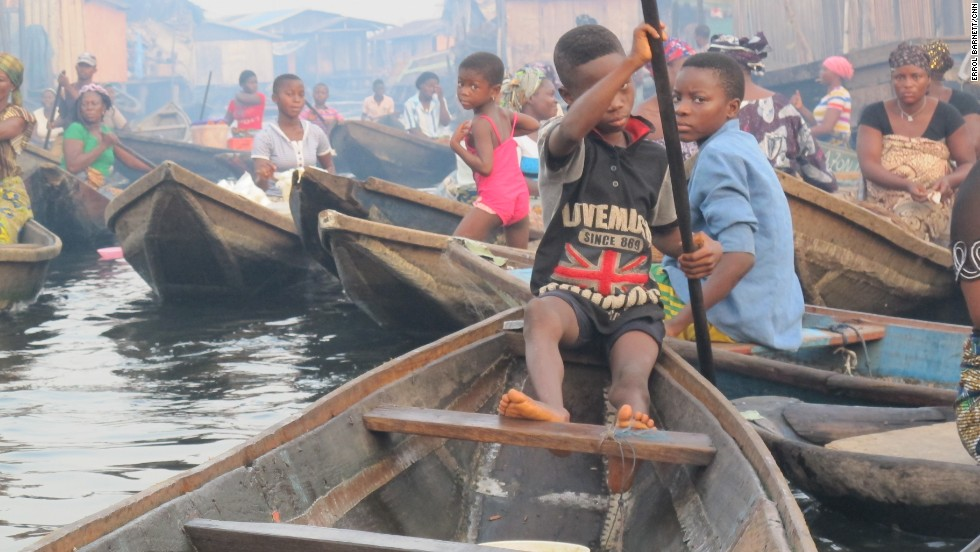 Just like any other busting town, there's even a rush hour here. Most children appear comfortable steering canoes as it is the only mode of transportation in an all-water community, but they must be careful.