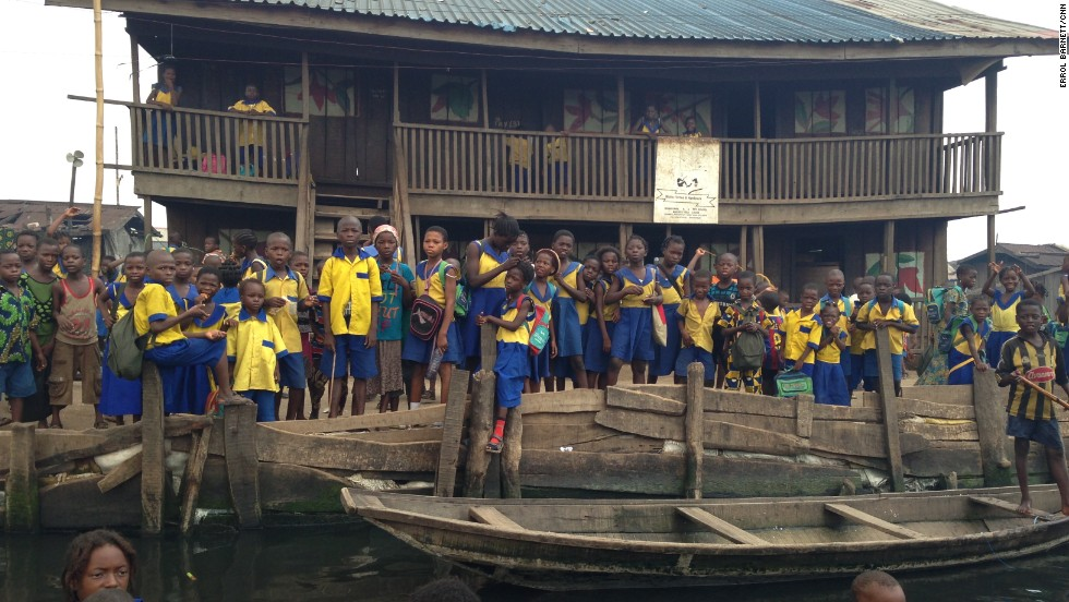NGOs and other charity organizations provided money to help build this school. It is the only primary school for Makoko's residents and is starting to bend and buckle just five years after it was built. It serves more than 300 students who can be seen here waiting for their canoe home.