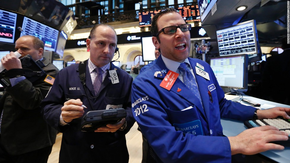 Traders work on the floor at the New York Stock Exchange, March 28.