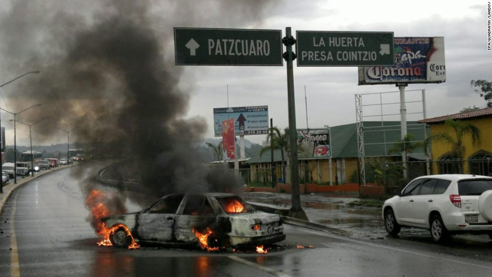 A car burns after several clashes between federal agents and allegedly hired killers in Michoacan on July 7, 2011. The clashes took place in Apatzingan, Uruapan and Maravatio.