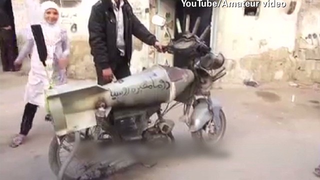 Syrians use humor and weapons to survive
