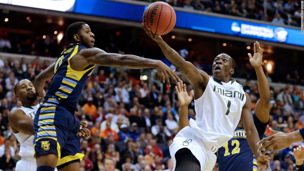 Durand Scott of Miami goes to the hoop against Jamil Wilson, left, of Marquette on March 28 in Washington.