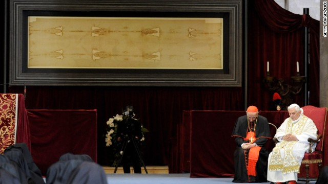 Pope Benedict XVI prays in front of the Holy Shroud in the Cathedral of Turin