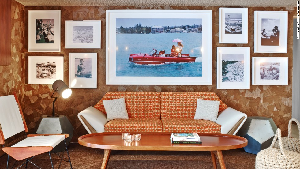 "A lounge at the James Royal Palm in Miami Beach features ""Sea Drive,"" a photograph by Slim Aaron."