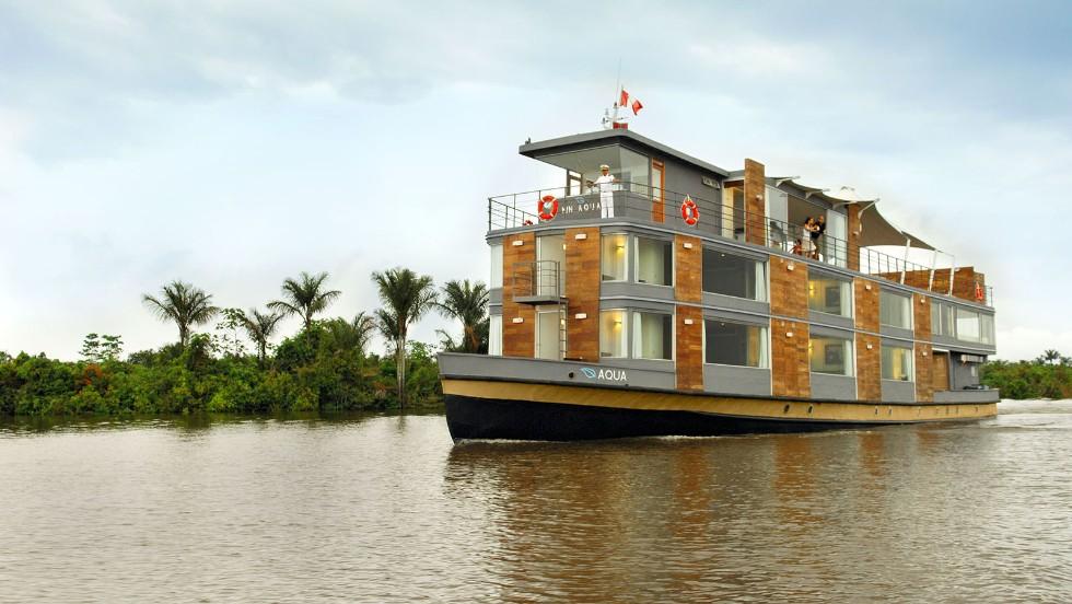 Aqua Expeditions' river boats explore the Amazon's less-traveled tributaries, floating deep into Peru's Pacaya Samiria National Reserve.