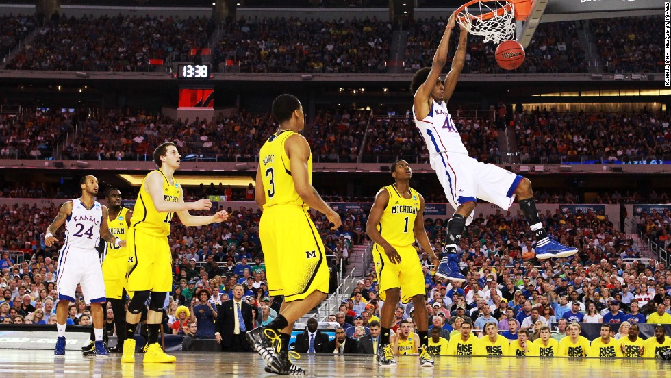 Kevin Young of Kansas dunks against Michigan on March 29.