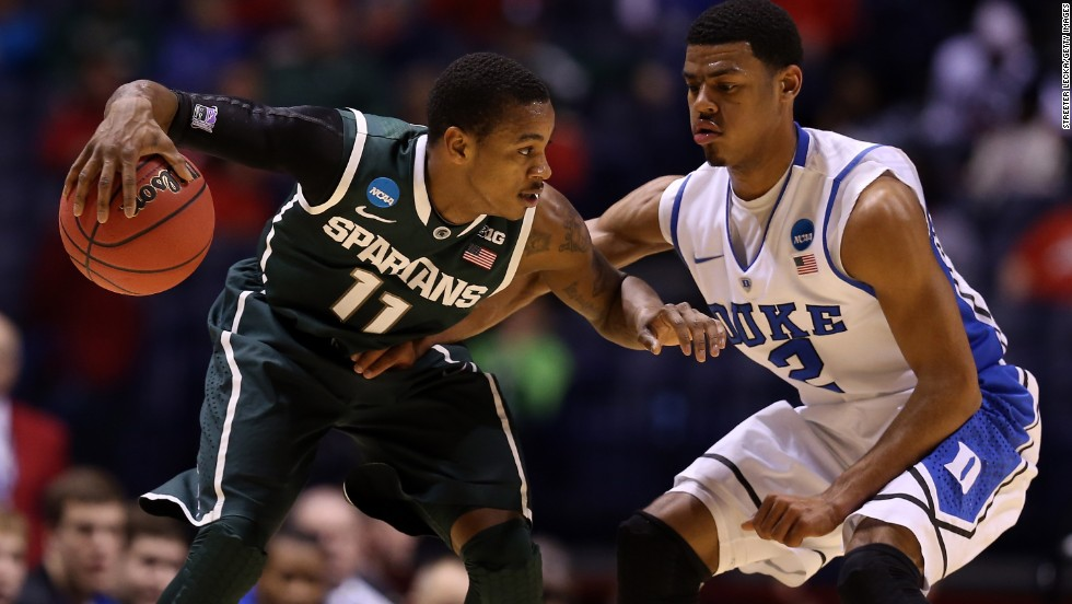 Keith Appling of Michigan State looks to drive the ball against Quinn Cook of Duke on March 29.