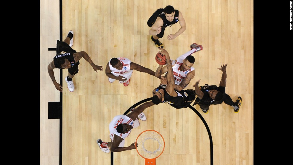 LaQuinton Ross of the Ohio State Buckeyes, middle center, goes up for a shot against the Wichita State Shockers on Saturday, March 30, in Los Angeles. Wichita State defeated Ohio State 70-66.