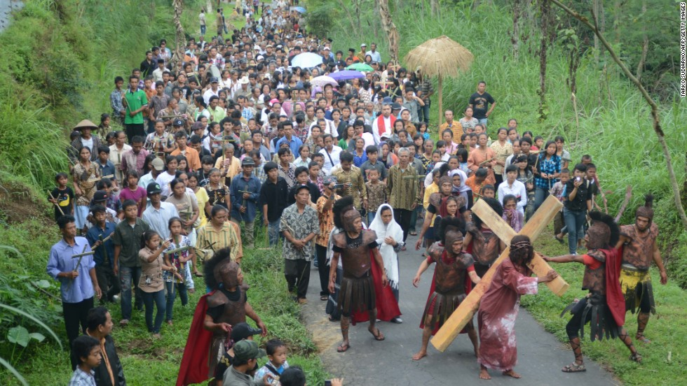 Indonesian Christian devotees take part in a procession re-enacting the crucifixion of Jesus Christ on Friday in the town of Magelang on the island of Java.