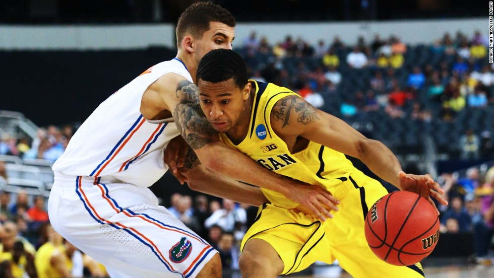 Trey Burke of the Michigan Wolverines, right, drives against Scottie Wilbekin of the Florida Gators on March 31 in Arlington, Texas. Michigan beat Florida with a final score of 79-59.