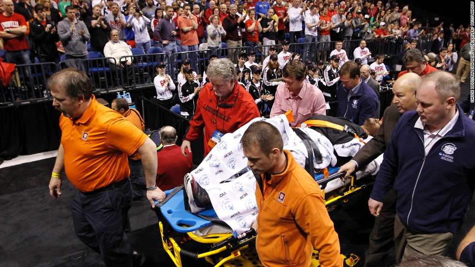 Ware is taken off the court on a stretcher.