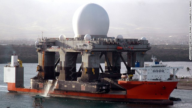 060109-N-3019M-012 Pearl Harbor, Hawaii (Jan. 9, 2006) - The heavy lift vessel MV Blue Marlin enters Pearl Harbor, Hawaii with the Sea Based X-Band Radar (SBX) aboard after completing a 15,000-mile journey from Corpus Christi, Texas. SBX is a combination of the world's largest phased array X-band radar carried aboard a mobile, ocean-going semi-submersible oil platform. It will provide the nation with highly advanced ballistic missile detection and will be able to discriminate a hostile warhead from decoys and countermeasures. SBX will undergo minor modifications, post-transit maintenance and routine inspections in Pearl Harbor before completing its voyage to its homeport of Adak, Alaska in the Aleutian Islands. U.S. Navy photo by Journalist 2nd Class Ryan C. McGinley (RELEASED)