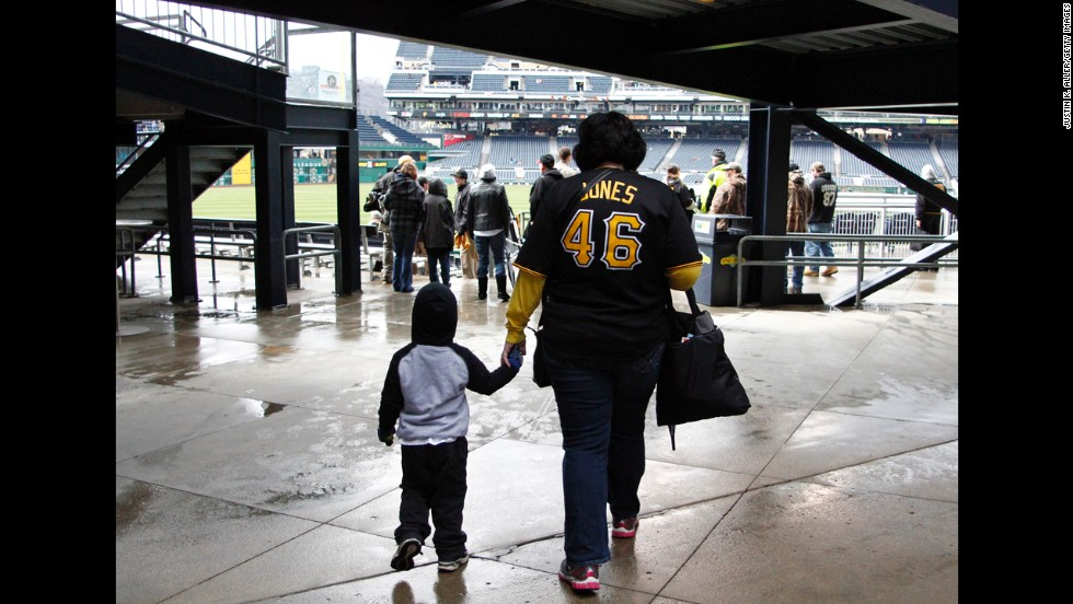 A woman and her son walk into PNC Park before the game between the Pirates and the Cubs.